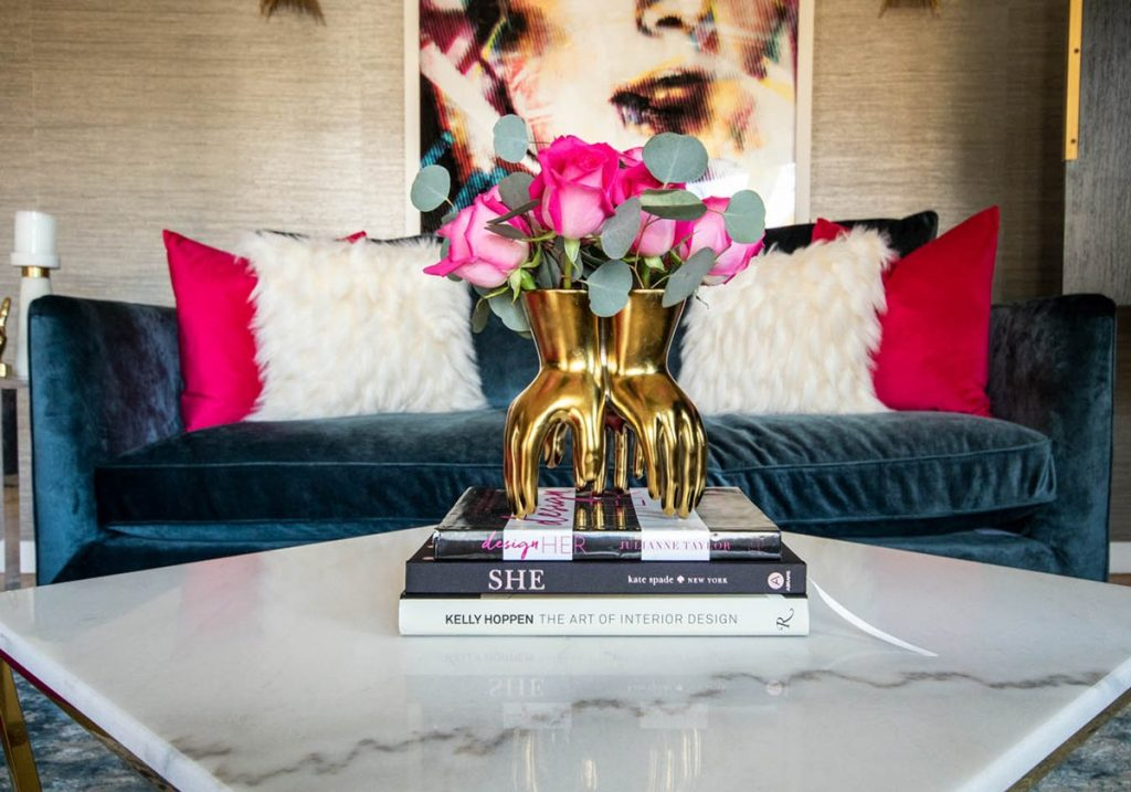 living-room-with-gold-hand-vase-and-fushia-pink-roses-1200x840