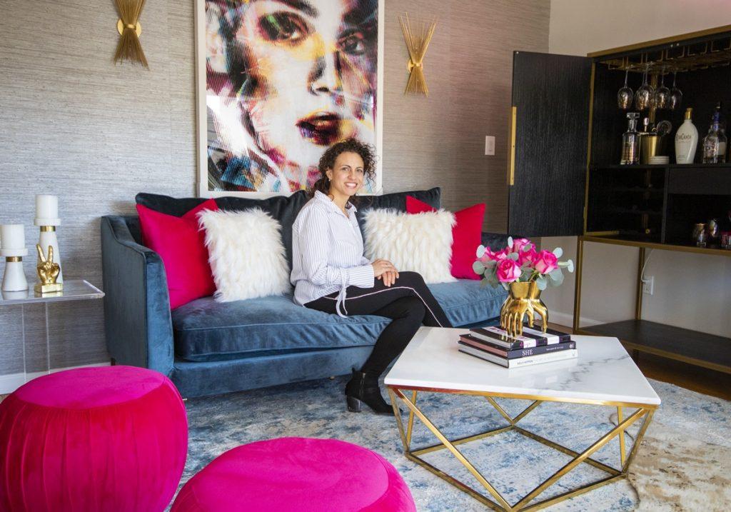 nyc-designer-on-blue-velvet-sofa-and-leftbank-art