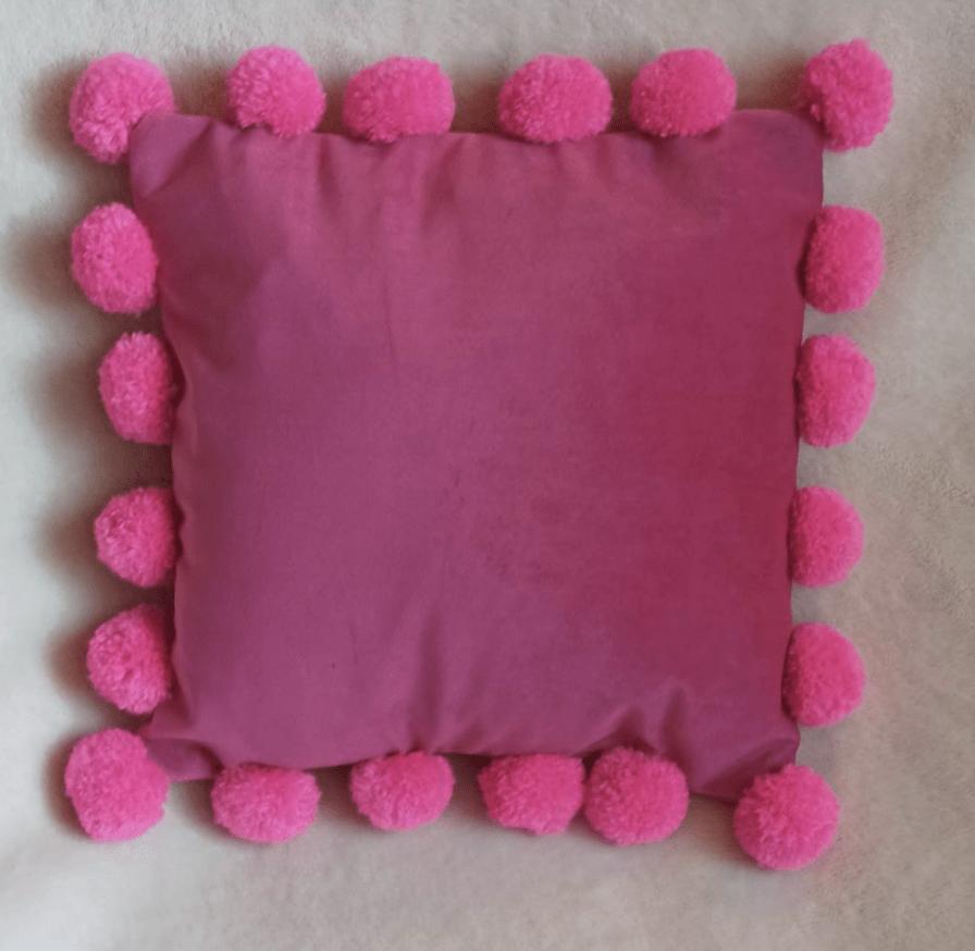 fuschia-velvet-pillow-with-pom-poms