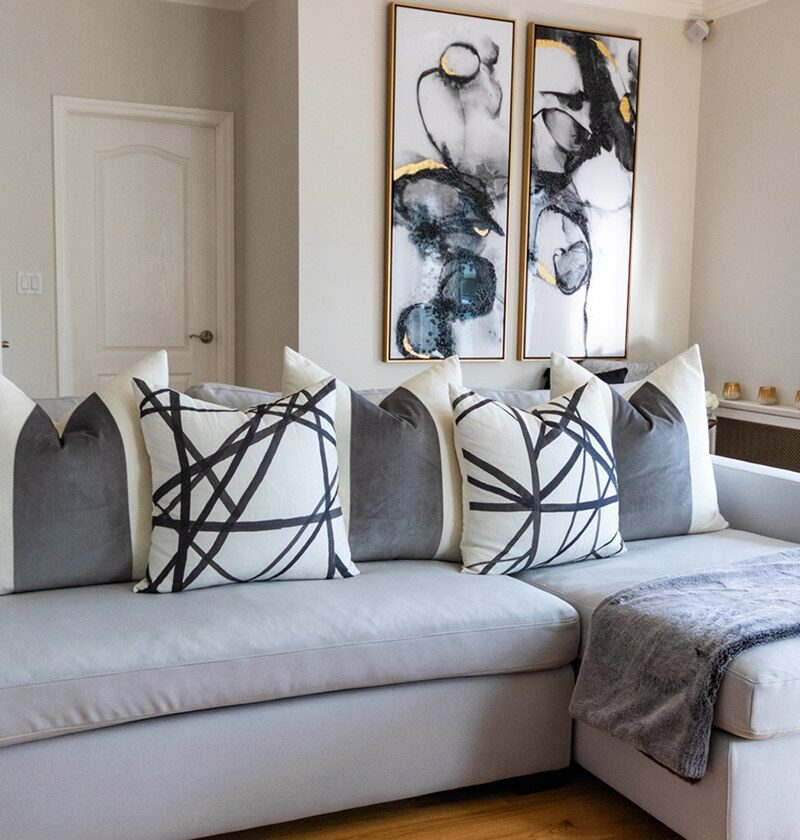 23 Modern Black And White Pillows That'll Totally Level Up Your Sofa