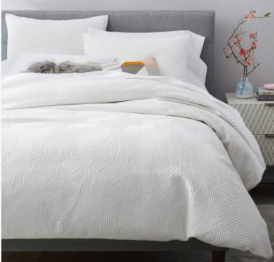 white-textured-bedding-bachelor-bedroom